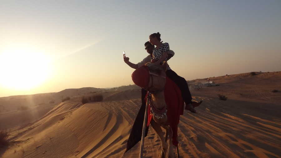 Watching the sunset on a camel, only in Dubai